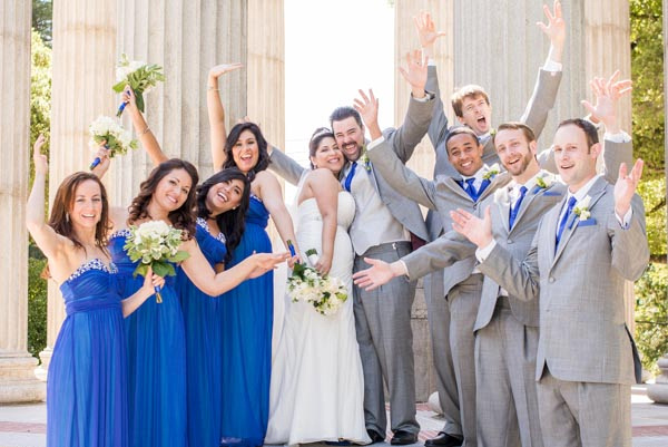 Bridal party cheering after outdoor wedding ceremony at Pulgas Water Temple in Woodside.