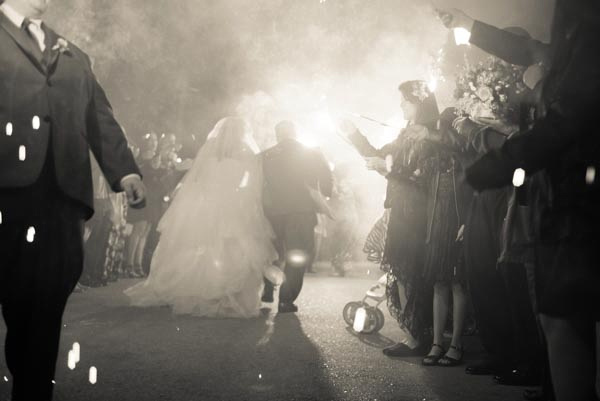 Bride and groom leaving to a sparkler send off after their wedding reception at Saratoga Mountain Winery.