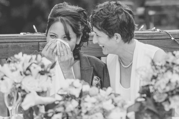 Brides smiling and crying during speech during wedding reception at The Pavilion at Redwood Estates.