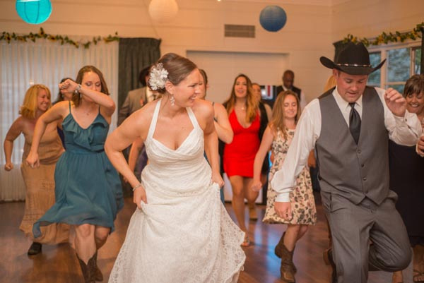 Bride and groom country line dancing with guests at their wedding reception at Highland Park in Ben Lomond.