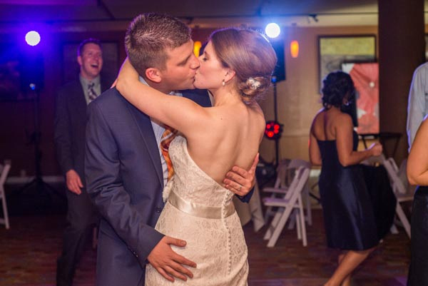 Bride and groom kissing on dance floor during their wedding reception at Chaminade Resort & Spa.