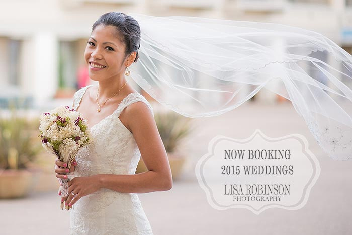 Photo advertisement of bride holding bouquet with veil blowing in the breeze. Text reads: now booking 2015 weddings. Lisa Robinson Photography.